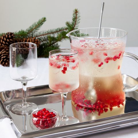 """<p class=""""p1""""><span class=""""s1""""><strong>Cava <em>Sangría </em>with Pomegranate Seeds </strong></span></p> <p class=""""p1""""><span class=""""s2""""><em>Total prep time: 10 minutes </em></span><span class=""""s3"""">SERVES 12</span></p> <p class=""""p1"""">2 cups seltzer, well chilled</p> <p class=""""p1"""">1 cup peach brandy, chilled</p> <p class=""""p1"""">1 cup fine sugar</p> <p class=""""p1"""">2 750-ml bottles of Cava (sparkling wine from Spain)</p> <p class=""""p1"""">1 1⁄2 cups pomegranate seeds</p> <p class=""""p1""""><span class=""""s1""""><strong>STIR </strong></span>seltzer, brandy, Cava, and sugar in a pitcher. When the sugar has dissolved, pour mix gently into another pitcher.</p> <p class=""""p1""""><span class=""""s1""""><strong>ADD </strong></span>1 cup of the pomegranate seeds to the sangria mix in the pitcher. Use the rest of seeds for the glasses.</p> <p class=""""p1""""><span class=""""s3""""><br /></span></p>"""