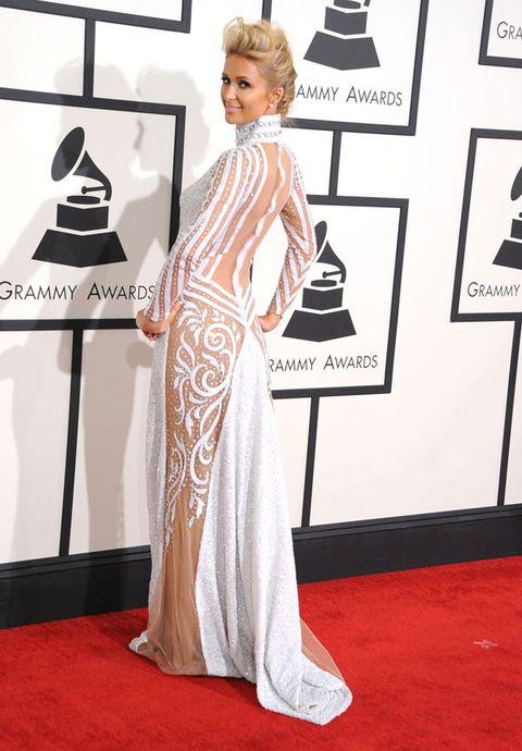 Flooring, Shoulder, Floor, Dress, Carpet, Style, Formal wear, Premiere, Fashion, One-piece garment,