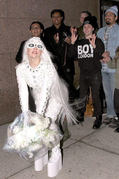 Face, Trousers, Hat, Textile, Bridal clothing, Veil, Bridal veil, Headgear, Dress, Fashion,