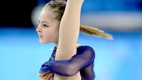 Sportswear, Gymnastics, Electric blue, Artistic gymnastics, Athlete, Chest, Physical fitness, Exercise, Leotard, Individual sports,
