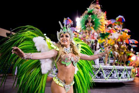 Entertainment, Performing arts, Samba, Event, Dancer, Fashion accessory, Abdomen, Headgear, Carnival, Performance,
