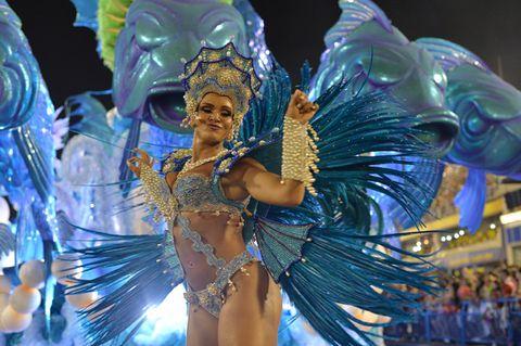 Event, Performing arts, Samba, Carnival, Headgear, Dancer, Art, Muscle, Public event, Abdomen,