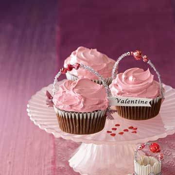 "Chocolate cupcakes topped with pink-tinted Swiss Meringue Buttercream are a decadent treat. Enjoy them plain or add glittery garnishes to dress them up for Valentine's Day.<br /><br /><a href=""http://www.countryliving.com/crafts/projects/valentines-crafts-0208"" target=""_blank"">Cupcake Instructions</a>"
