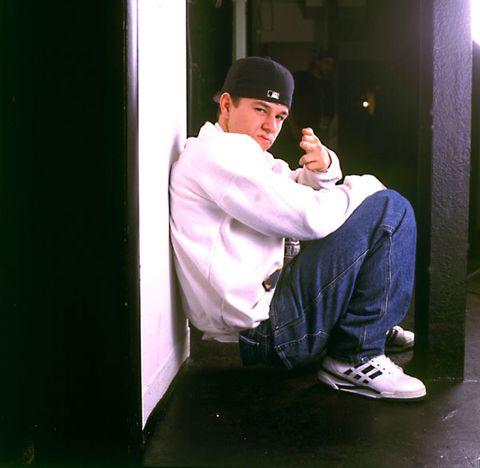 Cap, Sitting, Jeans, Street fashion, Denim, Baseball cap, Sneakers, Thinking, Cricket cap, Walking shoe,