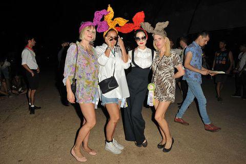 Footwear, Leg, Fun, Trousers, Social group, Jeans, Dress, Night, Hat, Headgear,