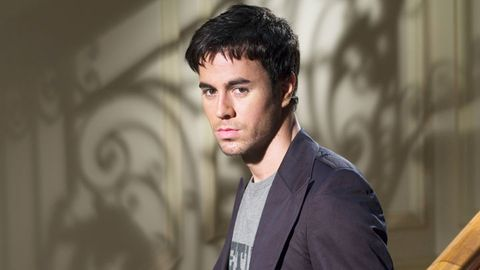 <p>Enrique Iglesias poses for a photo shoot. </p> <p><em>Photo credit: Corbis</em></p>