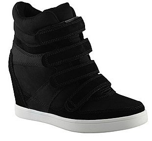 Whoever invented the wedge sneaker is seriously a genius. Who would ve  thought some day you d actually be able to rock your favorite kicks to work