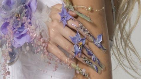 Skin, Purple, Muscle, Tattoo, Lavender, Body jewelry, Temporary tattoo, Nail, Abdomen, Natural material,