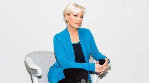 Sitting, Blazer, Electric blue, Chair, Jewellery, Blond, White-collar worker, Employment, Layered hair, Businessperson,