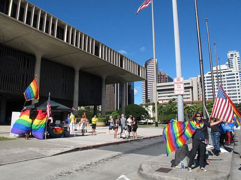 Flag, Pole, Road surface, Asphalt, Pedestrian, Landmark, Street, Metropolitan area, Flag of the united states, Parade,