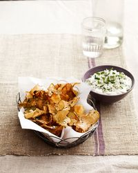 """<p>This seasonal take on chips and dip is full of deep, rich flavors and perfect for a Super Bowl bash.</p><p><strong>Recipe:</strong> <a href=""""http://www.countryliving.com/recipefinder/sunchoke-chips-warm-blue-cheese-dip-recipe-clv0214"""" target=""""_self"""">Sunchoke Chips with Warm Blue-Cheese Dip</a></p>"""