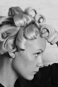 Wrap quarter-inch sections of hair around your index and middle fingers, following the direction of the curl you created with the curling iron. Pin each section with a duck-bill clip. Mist on a non-sticky hairspray.