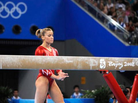 Who knew four inches could unnerve even the toughest athletes? That's how wide the balance beam is.