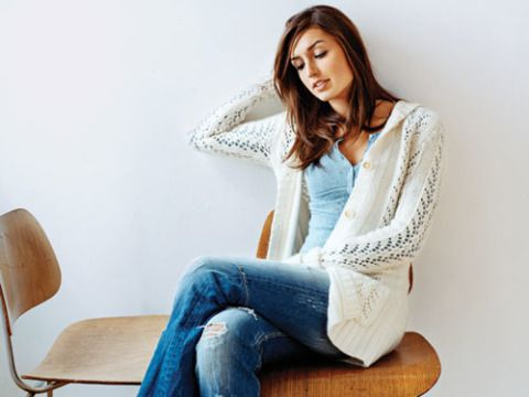 Clothing, Sleeve, Comfort, Sitting, Human body, Shoulder, Denim, Jeans, Textile, Joint,