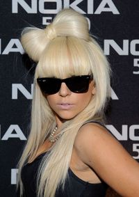 "<p>The 'do that started it all. Back in the ""Poker Face"" era, Gaga set the club world on fire with this cheeky hair bow. RuPaul's Drag Race has yet to get over it.</p>"