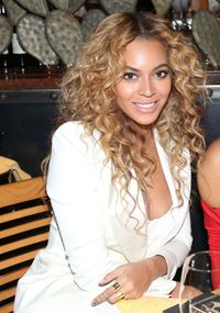 <p><strong>What To Ask For:</strong> Long, overdirected layers. If you have super curly hair, like Bey, ask your stylist to cut it dry, so you can see exactly how the style will look!</p>