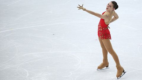 Ice skate, People in nature, Waist, Thigh, Abdomen, Trunk, Figure skating, Skating, One-piece garment, Ankle,