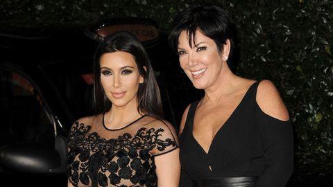 Kim Kardashian and mom Kris Jenner arrive at an event.