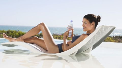 Skin, Photograph, Elbow, Leisure, Happy, People in nature, Summer, Plastic bottle, Sitting, Comfort,