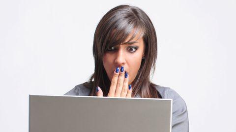 Shocked Woman on Laptop