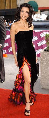 """<p><span id=""""internal-source-marker_0.643264318033158"""">We don't know whether to look at her leg or her jesus piece but we love this flamenco inspired dress Eva wore to the 2002 Emmy's. If you're looking for your own crucifix jewelry try  a necklace like Eva's or a bracelet like <a title=""""Bracelet"""" href=""""http://us.topshop.com/webapp/wcs/stores/servlet/ProductDisplay?beginIndex=1&viewAllFlag=&catalogId=33060&storeId=13052&productId=8941057&langId=-1&sort_field=Relevance&categoryId=208714&parent_categoryId=208582&pageSize=20%20http://www.gettyimages.com/detail/news-photo/young-and-the-restless-actress-eva-longoria-arrives-on-may-news-photo/1543150%20"""" target=""""_blank"""">this one</a>. </span></p>"""