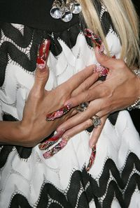 <p>Violets are blue. These nails look an absolute hot mess on you!!</p>