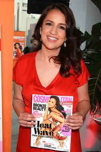 Cosmo For Latinas Editor-in-Chief Michelle Herrera Mulligan holding a copy of the launch issue.