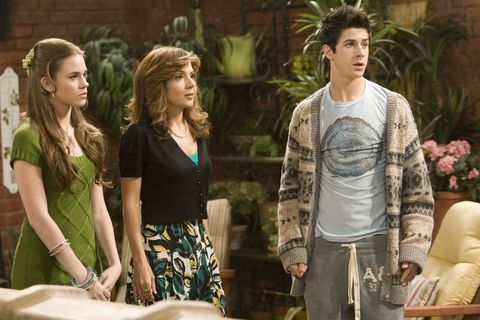 Wizards of Waverly Place started with a conservative approach. Note how they have the character of Teresa, played by Maria Canals Barrera, in a loose cardigan hardly showing off her figure. We are loving the homage to Farrah Fawcett with the hair though.