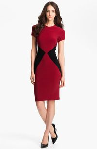 <p>Be the lady in red with this color blocked sheath dress by KAMALIKULTURE. The colors distract the eye and hug you in all the right places.</p>