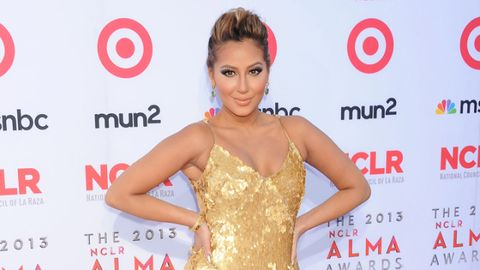 <p>Glitz and glam in a gold sequined gown, Adrienne Bailon stunned on the red carpet. Gold is the perfect color to start adding to your closet now. It's great for holiday season!</p>