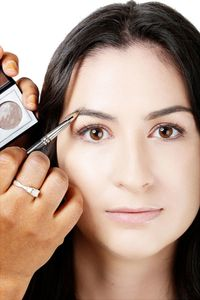 "<p>Brush your brows up ""for a more youthful and groomed look."" Fill in any sparse areas with a stiff, flat brush such as the M.A.C 212 Flat Definer Brush and a muted brown pressed powder like M.A.C Eye Shadow in Concrete. ""Concrete is a good universal shade for either blondes or brunettes because of its ashy brown hue,"" Fatima explains. Another good option to try? Nars Matte Eyeshadow in Bali.</p>"