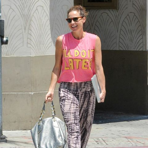 Minnie Driver wearing a slogan t-shirt