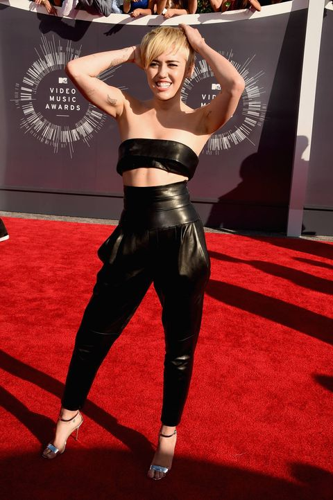 Miley Cyrus looks sexy in leather two-piece on the MTV Video Music Awards red carpet