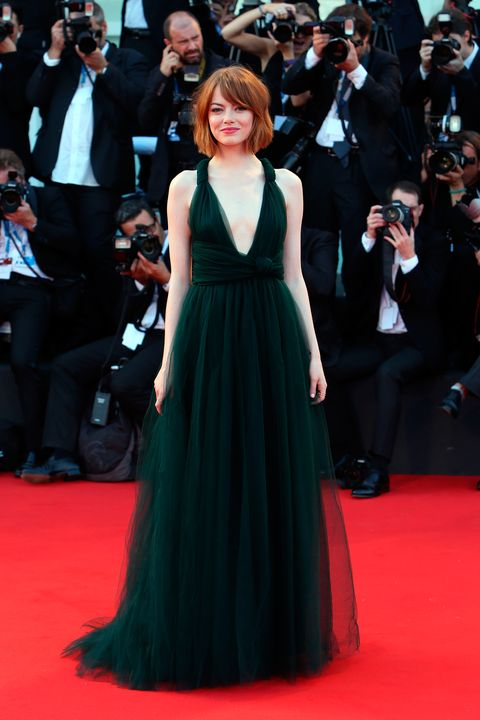 Emma Stone wears plunging Valentino dress at Birdman premiere in Venice