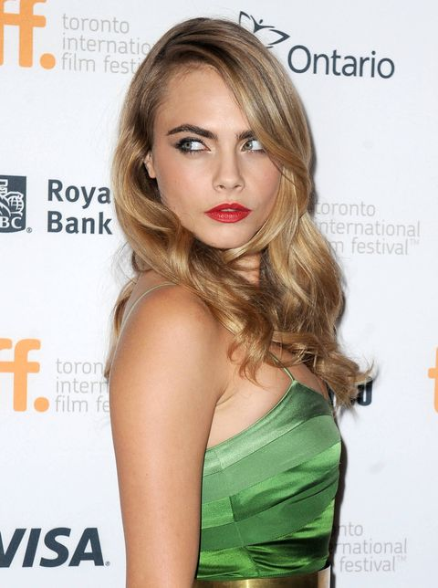 Cara Delevingne in a green gown
