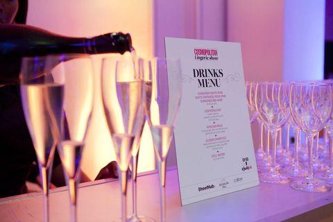 Glass, Drinkware, Stemware, Barware, Wine glass, Drink, Wine bottle, Bottle, Purple, Champagne stemware,