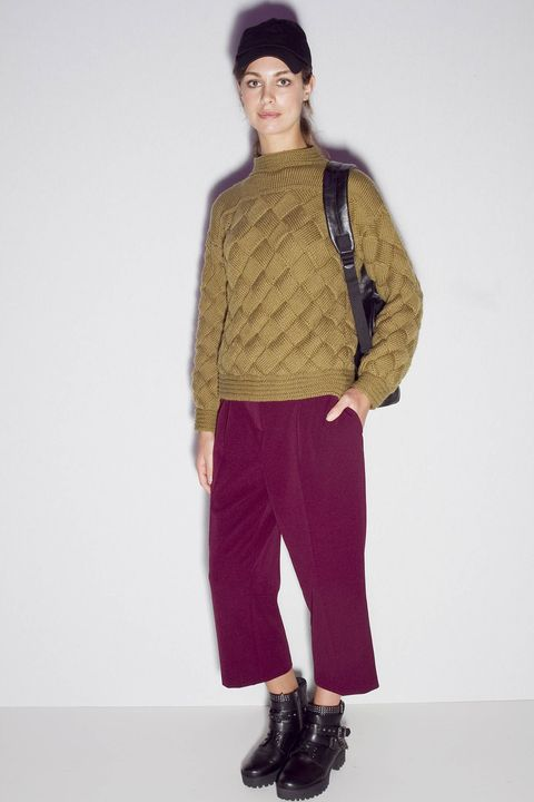 Brown, Sleeve, Human body, Shoulder, Textile, Joint, Outerwear, Standing, Boot, Style,