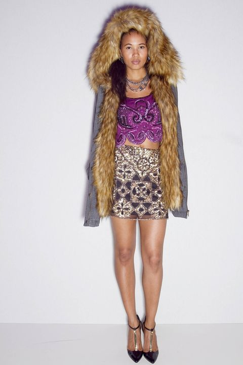 Brown, Shoulder, Textile, Fashion show, Joint, Outerwear, Human leg, Fur clothing, Style, Fashion model,