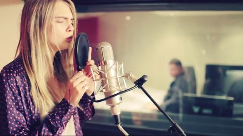 Cara Delevingne singing