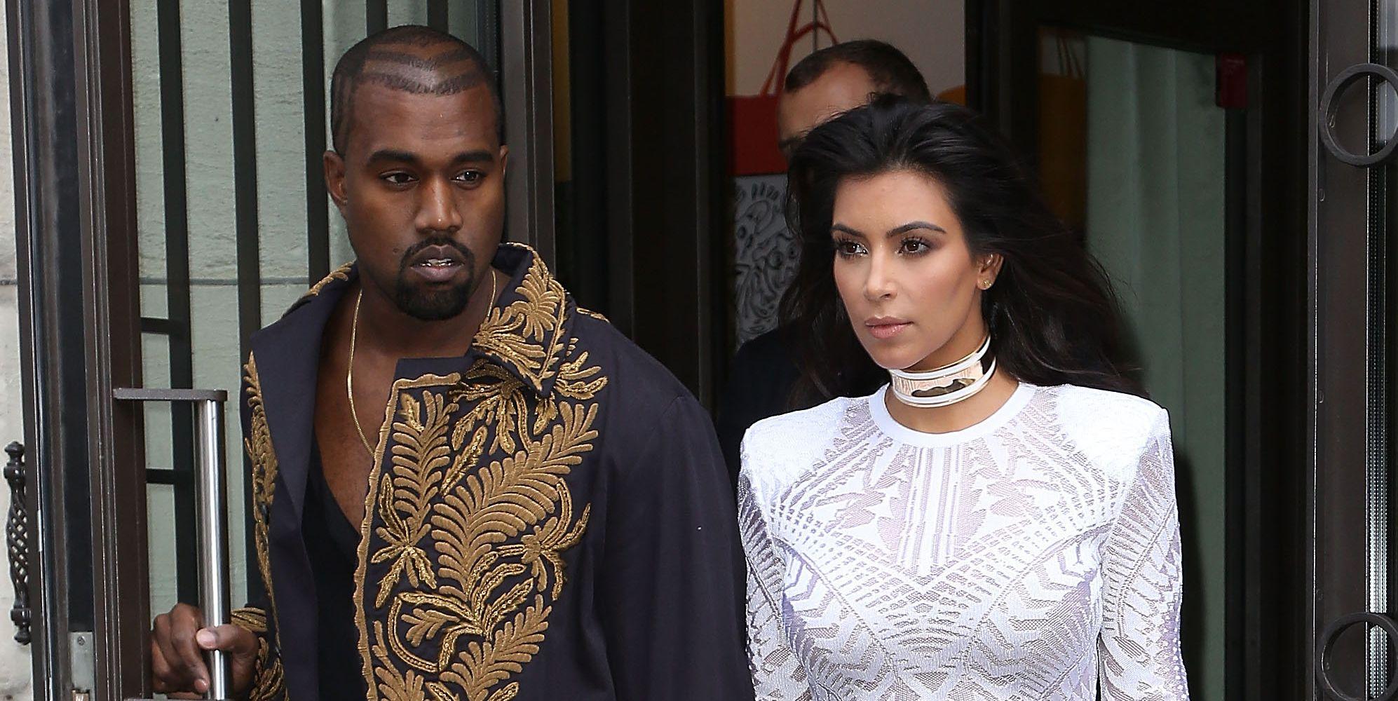 Kanye West and Kim Kardashian arriving at the Balmain Spring 2015 show