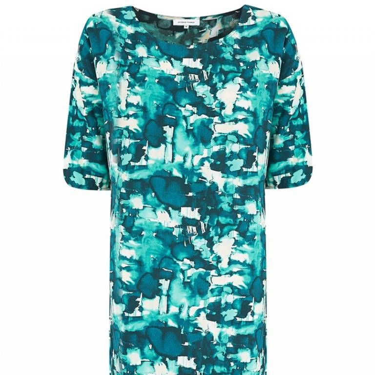 A wavy, loose hair 'do underneath a huge white hat would make this fun, printed dress sing.
