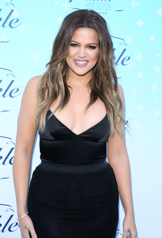Khloe Kardashian wearing a black dress to a cocktail launch
