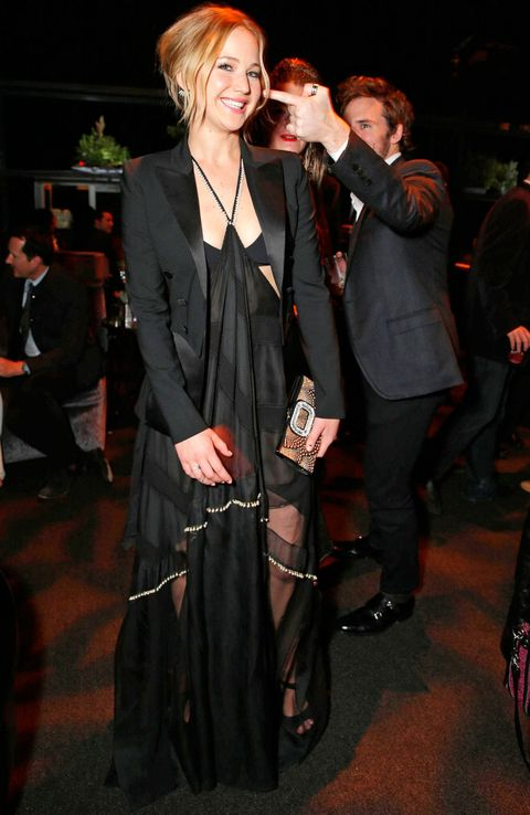 Jennifer Lawrence wearing a black sheer gown at the Hunger Games LA after party