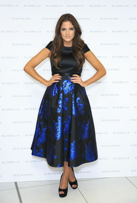 Made In Chelsea's Binky Felstead wears a floral satin midi skirt at her lingerie launch