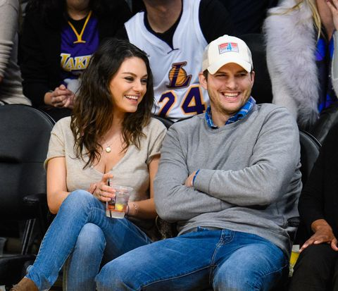 Ashton Kutcher and Mila Kunis go to the ball game in their first outing since becoming parents