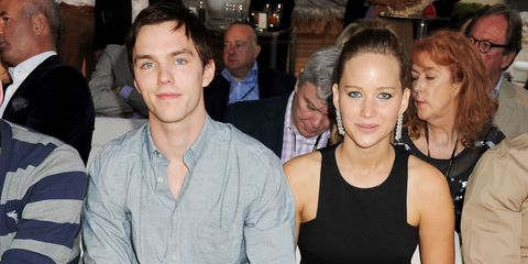 Jennifer Lawrence and Nicholas Hoult sit front row at a fashion show