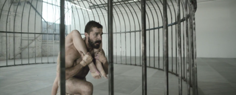 Shia LaBeouf and Maddie Ziegler in a cage for Sia's music video for Elastic Heart