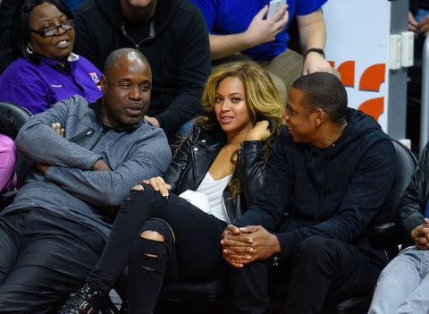 Beyoncé and  Jay Z at a basketball game