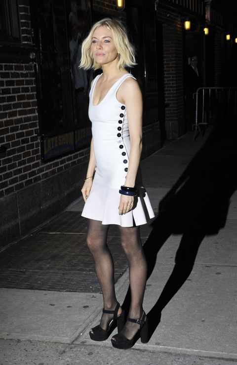 Sienna Miller outside the Late Show with David Letterman wearing a white dress