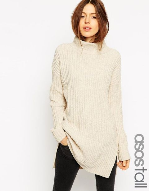 Sweater, Sleeve, Human body, Shoulder, Textile, Standing, Joint, White, Style, Pattern,
